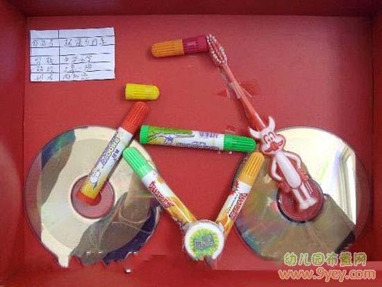 幼儿园废旧物品手工:光盘制作自行车